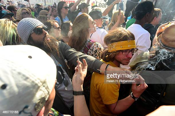 Hundreds of people lit up joints bongs pipes and marijuana cigarettes at exactly 420 pm during the Colorado 420 Rally at Civic Center Park in Denver...