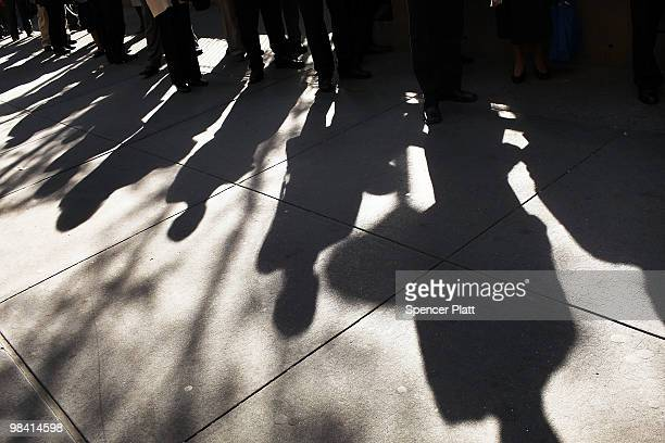 Hundreds of people looking for employment wait in line to at an AARP job fair with an emphasis on individuals 50 years old and over on April 12 2010...