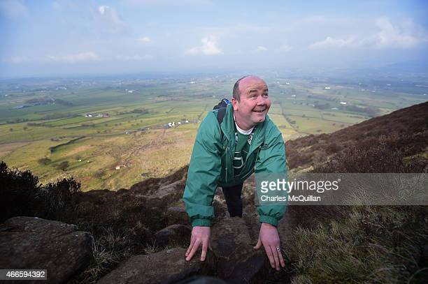 Hundreds of people make the St. Patrick's Day pilgrimage to the top of Slemish on March 17, 2015 in Ballymena, Northern Ireland. Slemish Mountain is...