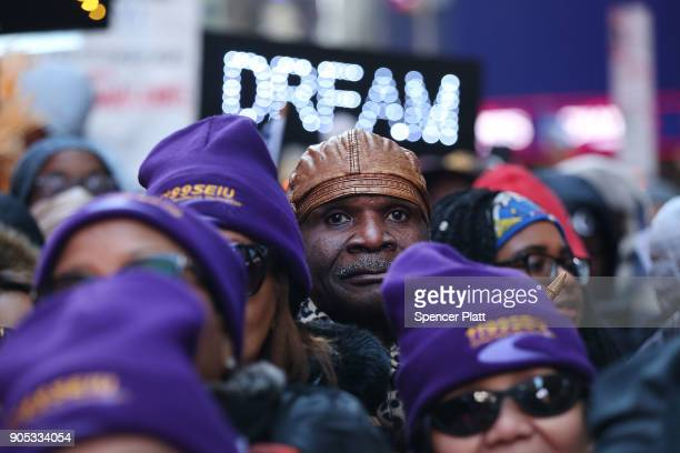 Hundreds of people many of them Haitian demonstrate against racism in Times Square on Martin Luther King Day on January 15 2018 in New York City...