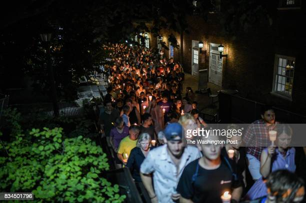 Hundreds of people march peacefully with lit candles across the University of Virginia campus on Wednesday August 116 in Charlottesville VA in the...