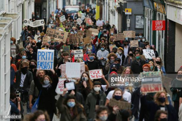 """Hundreds of people march through the streets of Falmouth on March 27, 2021 in Falmouth, England. """"Kill the Bill"""" protests, in opposition to the new..."""