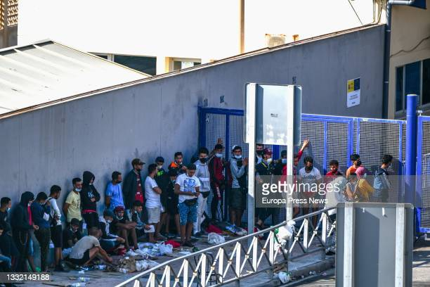 Hundreds of people, mostly Moroccans, queue at the asylum office located at the Tarajal border that separates Ceuta from Morocco, on 3 August 2021 in...