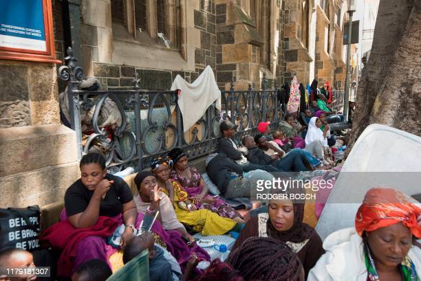 Hundreds of people originally from the Democratic Republic of Congo, Rwanda, Burundi, and Bangladesh are seen outside the Methodist Church where have...