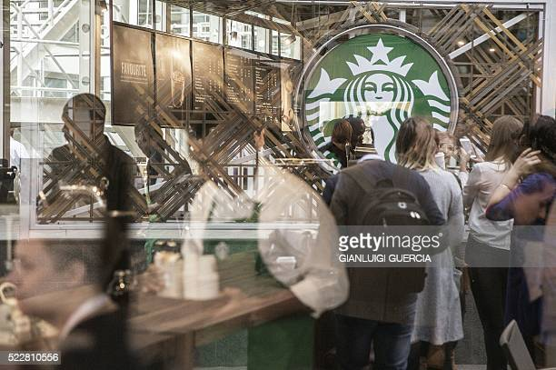 Hundreds of people queue during the official opening of South Africa's first Starbucks store also the US coffeehouse chain's first store in...