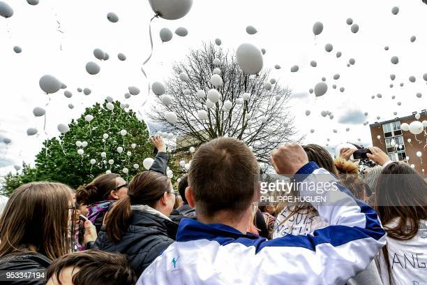 TOPSHOT Hundreds of people release white balloons as they take part in a march in Wambrechies northern France on May 1 in tribute to Angelique a...