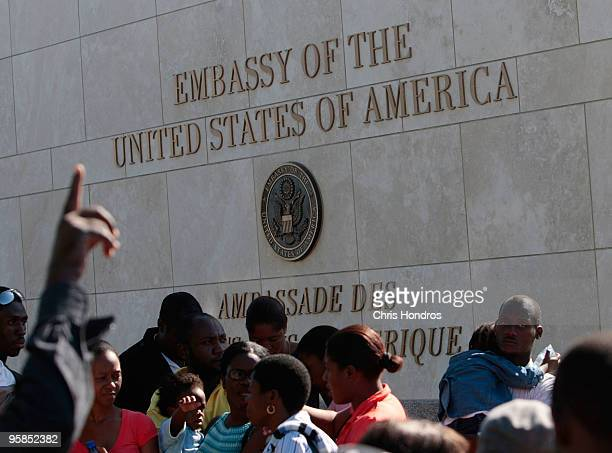 Hundreds of people some with US passports stand in a long line outside of the American embassy as they try to leave the country January 18 2010 in...