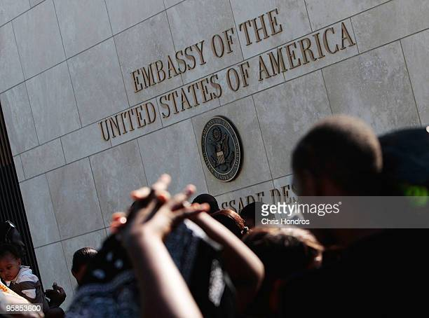 Hundreds of people some with US passports stand in a long line outside of the American embassy as they try to escape Haiti January 18 2010 in...
