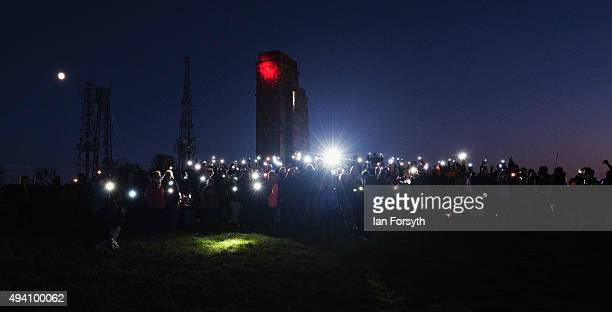 Hundreds of people stand in front of Eston Nab during a torchlit procession on the top of the Eston Hills on October 24 2015 in Eston Cleveland The...