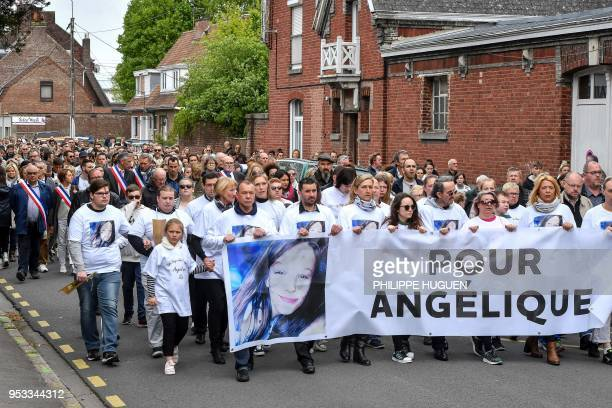 Hundreds of people take part in a march in Wambrechies northern France on May 1 in tribute to Angelique a 13yearold girl who was killed and raped on...