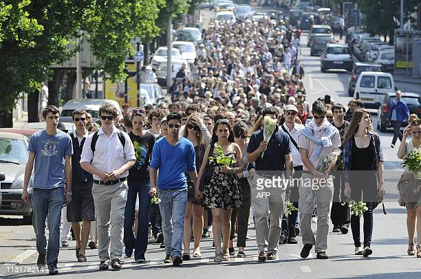 Hundreds of people take part in a march on April 26 2011 in the French western city of Nantes in memory of the five Dupont de Ligonnes family members...
