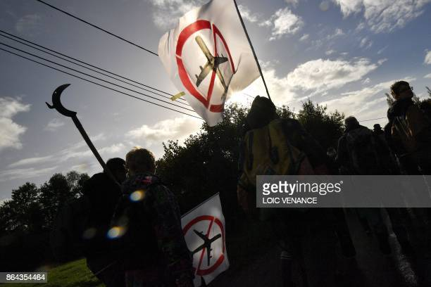 Hundreds of people take part in a march organised by opponents to a controversial international airport project in the area on October 21 in the Zad...
