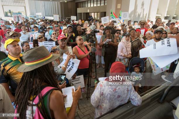 Hundreds of people take part in a protest against the way the Cape Town city council has dealt with issues around water shortages on January 28 in...