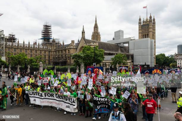 Hundreds of people take part in a protest march from the Home Office to Downing Street in central London a year after the Grenfell Tower fire which...