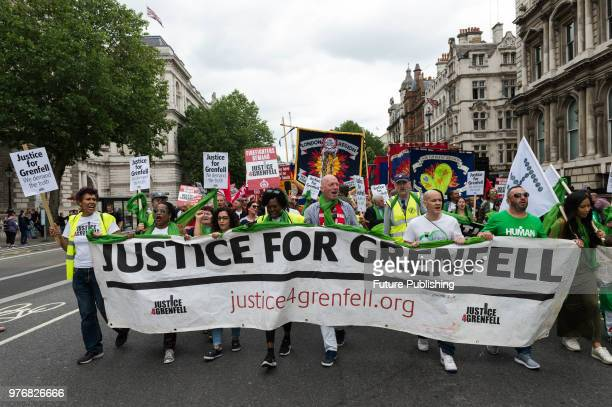Hundreds of people take part in a protest march through central London to the Home Office a year after the Grenfell Tower fire which took the lives...