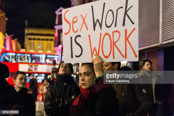 Hundreds of people take part in a protest march through London's Soho district on International Women's Day against criminalisation of sex work as...