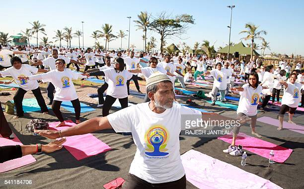 Hundreds of people take part in a yoga session as part of the International Day of Yoga at the amphitheatre lawns at North Beach on June 19 2016 in...