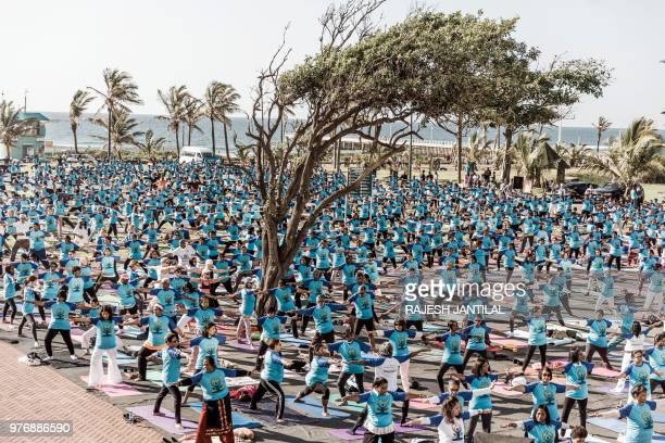 TOPSHOT Hundreds of people take part in a yoga session at North Beach on June 17 2018 in Durban South Africa ahead of the International Day of Yoga...