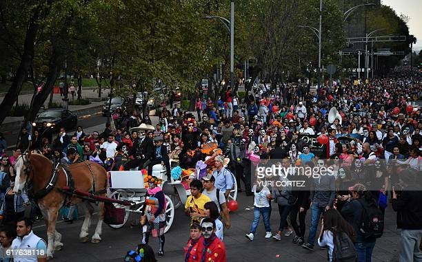 Hundreds of people take part in the Catrinas Parade along Reforma Avenue in Mexico City on October 23 2016 Mexicans get ready to celebrate the Day of...