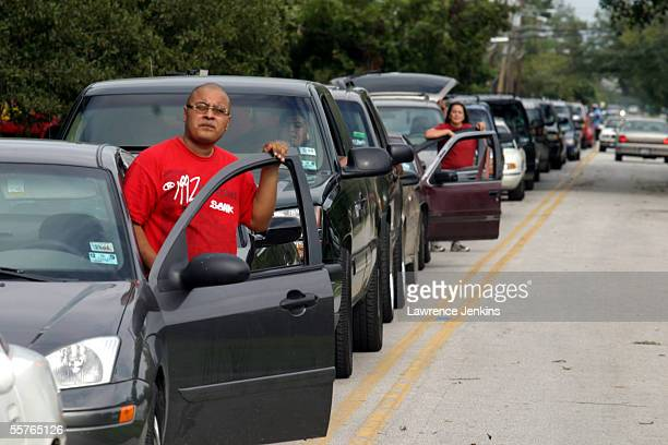 Hundreds of people wait in line for up to three hours for gas at a Texaco on I45 September 24 2005 in northwest Houston Texas Hurricane Rita made...