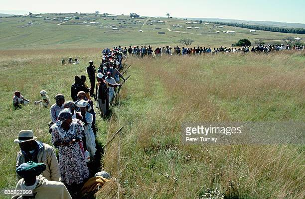 Hundreds of people wait in line to vote in Nelson Mandela's home village in the first democratic election in South Africa