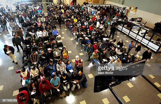 Hundreds of people without legal status lineup inside the Department Of Motor Vehicles office in Stanton California for an opportunity to get their...