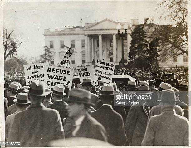 Hundreds of persons thronged in front of the White House on December 7th to watch the band of unemployed who failed in an attempt to present to...