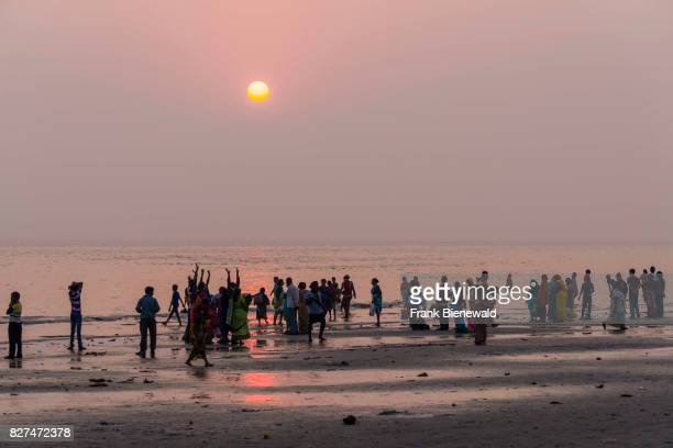 Hundreds of pilgrims are gathering on the beach of Ganga Sagar at sunset celebrating Maghi Purnima festival