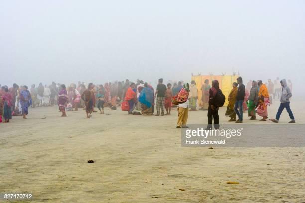 Hundreds of pilgrims are gathering on the beach of Ganga Sagar in the morning fog celebrating Maghi Purnima festival