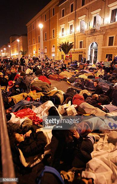 Hundreds of pilgrims camp outside Saint Peter's Square just past midnight waiting for the funeral of Pope John Paul II April 8, 2005 in Rome, Italy....