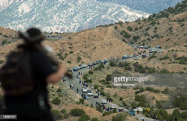 Hundreds of pilgrims hike a desert highway in New Mexico to the Santuario de Chimayo Church April 18 2003 in Chimayo New Mexico Locals say the earth...