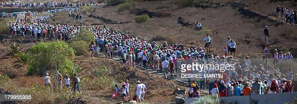 Hundreds of pilgrims take part in the annual procession of the Virgin del Socorro on the Spanish Canary island of Tenerife on September 7 2013 The...