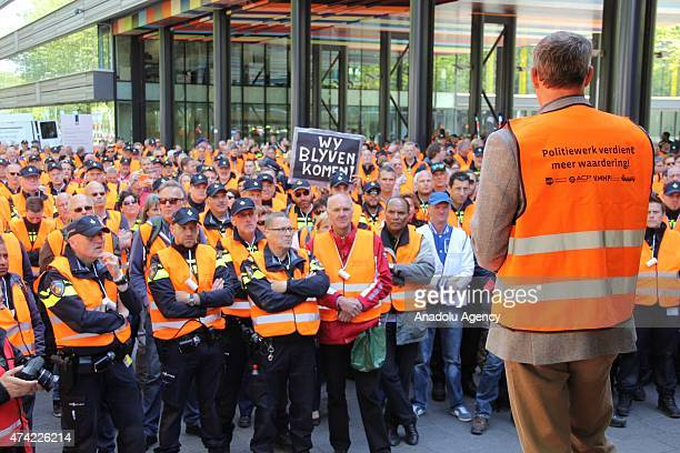 Hundreds of police gather to protest demanding salary increases and improving their working conditions outside the parliament in The Hague...