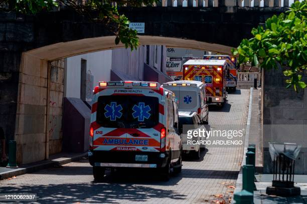 Hundreds of private and municipal paramedics protest in their ambulances through Old San Juan and drive in front of the governor's mansion to demand...