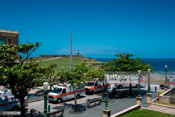 Hundreds of private and municipal paramedics protest in their ambulances through Old San Juan and driving in front of the governor's mansion to...