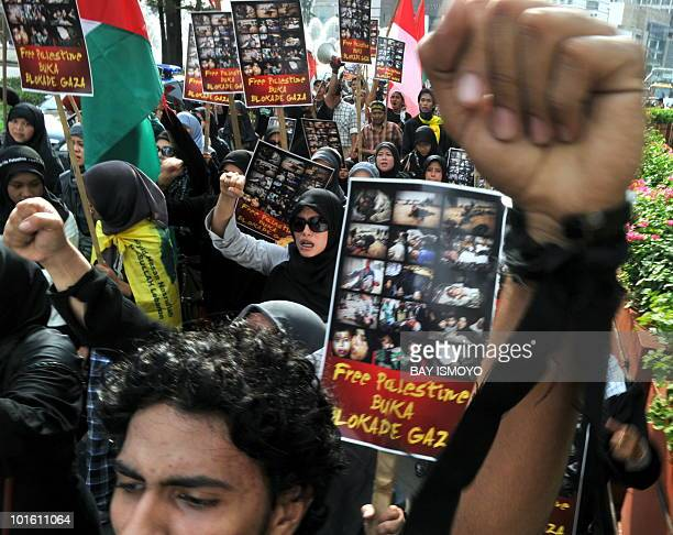 Hundreds of proPalestine demonstrators carry flags and wave placards reading 'Free Palestine and reopen the blockade of Gaza strip' as they march in...