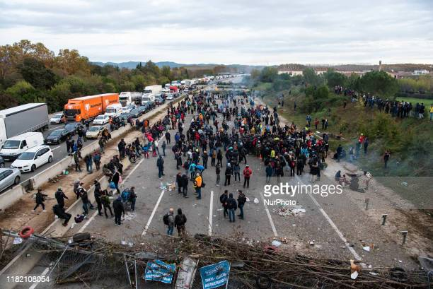 Hundreds of protesters are still concentrated in the highway AP7 in Salt, Girona, Spain on November 13, 2019. They protest for the judgement to the...