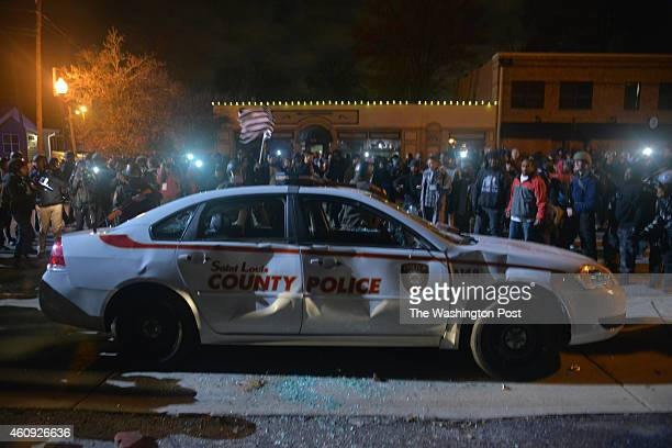 Hundreds of protesters gather after an announcement that Ferguson police officer Darren Willson will not be indicted in the fatal shooting of unarmed...