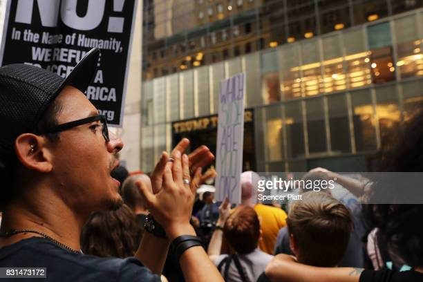 Hundreds of protesters gather outside of Trump Tower along Fifth Avenue on August 14, 2017 in New York City. Security throughout the area is high as...