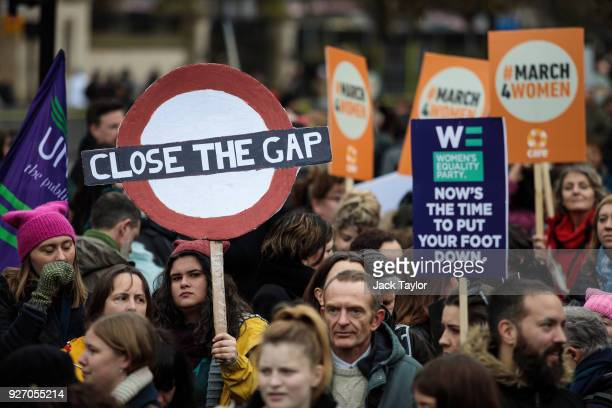 Hundreds of protesters gather with placards outside the House of Parliament during the March4Women event on March 4 2018 in London England...