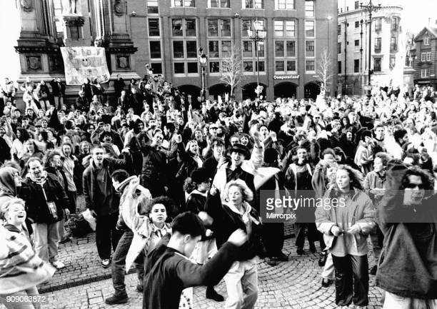 Hundreds of protesters hold a huge acid house party in Albert Square Manchester in protest against police harassment of their gatherings February 1990