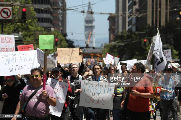 Hundreds of protesters march on Market Street in front of the offices of US Sen Dianne Feinstein during a demonstration against migrant detention...