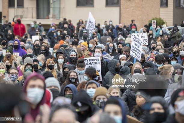 Hundreds of protesters stand in front of the Brooklyn Center police department after the police killing of Daunte Wright in Brooklyn Center,...