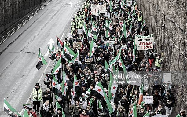 Hundreds of protestors join a march of Syrian opposition supporters in London, United Kingdom, 16 March 2013. The march was held in solidarity with...