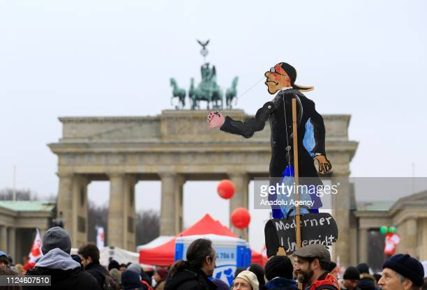 Hundreds of public employees gather in front of the Brandenburg Gate during a demonstration, called by trade unions, for demanding the increases of...