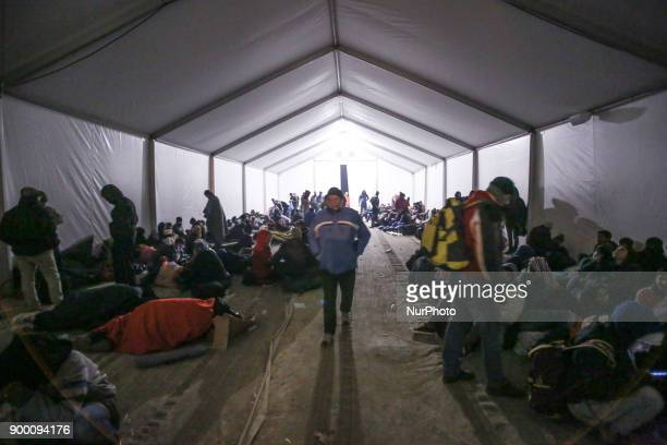 Hundreds of refugees and migrants arrive from the islands and the mainland of Greece in the GreekFYROM borders in November 2015 They wait in lines in...