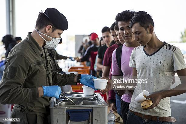 Hundreds of refugees receive food as they arrive at the Hungarian and Austrian border in Hegyeshalom Hungary on September 23 2015