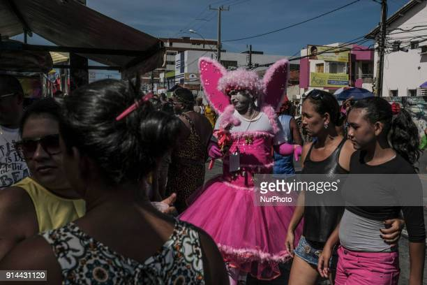 Hundreds of revelers accompany a block of carnival known as the Virgins of Olinda where men traditionally dress in women's clothing during a...