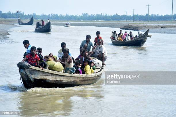 Hundreds of Rohingya people crossing Bangladesh's border as they flee from Buchidong at Myanmar after crossing the Nuf River Shah Porir Dwip Island...