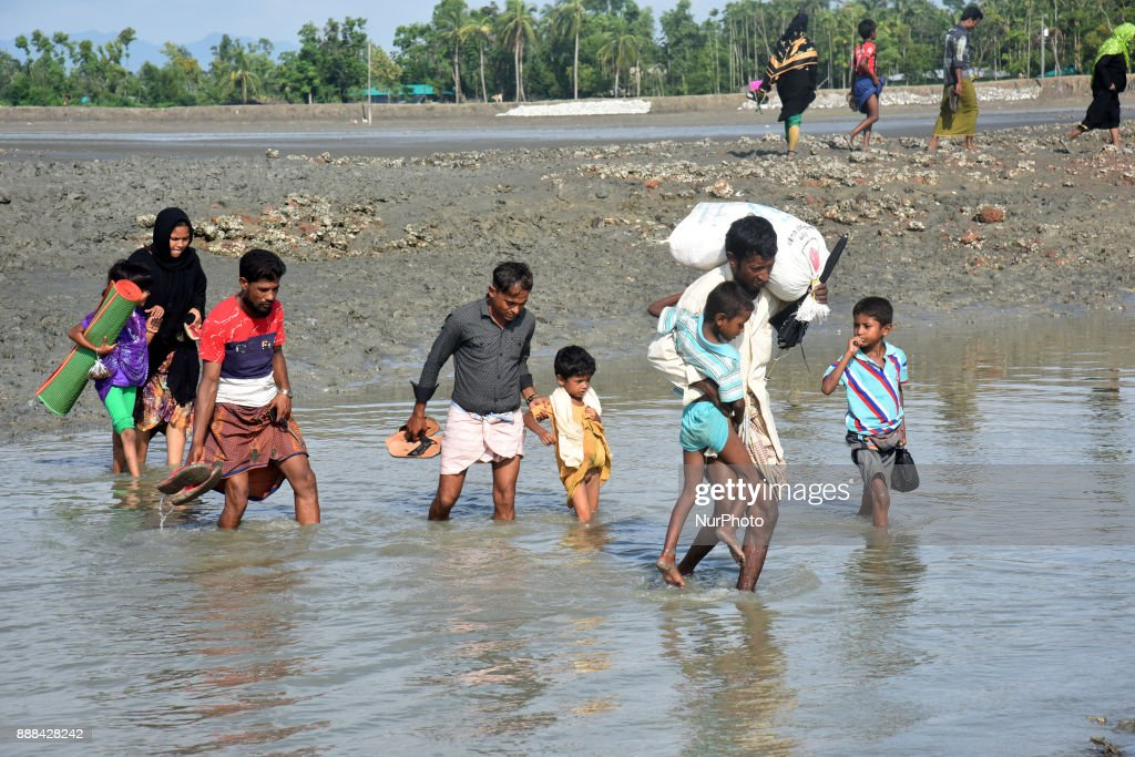 Hundreds of Rohingya people crossing Bangladesh's border as they flee from Buchidong at Myanmar after crossing the Nuf River Shah Porir Dwip Island near Teknaf in Cox's Bazar, Bangladesh, on September 07, 2017. According to the United Nations High Commissioner for Refugees (UNHCR) more than 525,000 Rohingya refugees have fled from Myanmar for violence over the last month with most of them trying to cross border reach Bangladesh. International organizations have reported claims of human rights violations and summary executions allegedly carried out by the Myanmar army.